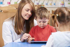 Teacher assessing young student